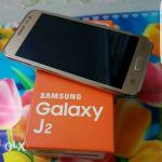 samsung-j2-gold-fullset--headset--sd-card