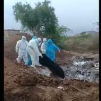 viral-jenazah-korban-covid-19-dilempar-ke-lubang-oleh-petugas-medis-bikin-geger