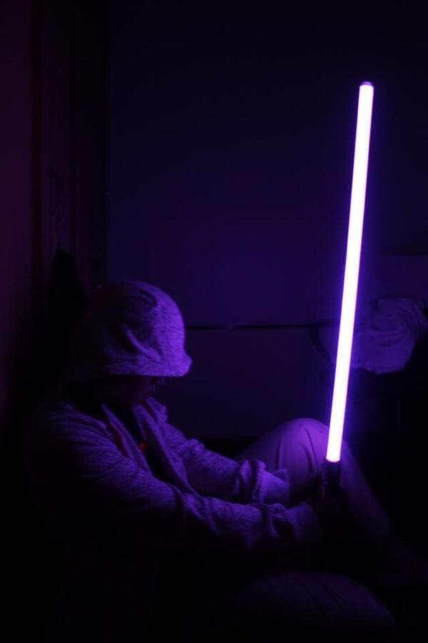 Starwars lightsaber and helmet