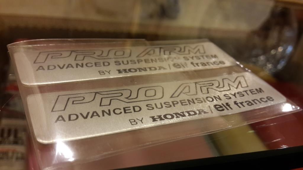 WTS Emblem alumunium Pro Arm Honda NSR 150 SP (logo Honda / ELF France)