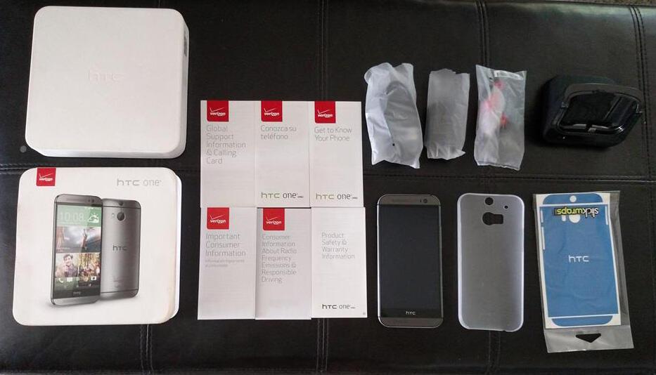 HTC one M8 32 GB Verizon + desktop charger (hdmi out) + slickwraps + melkco case
