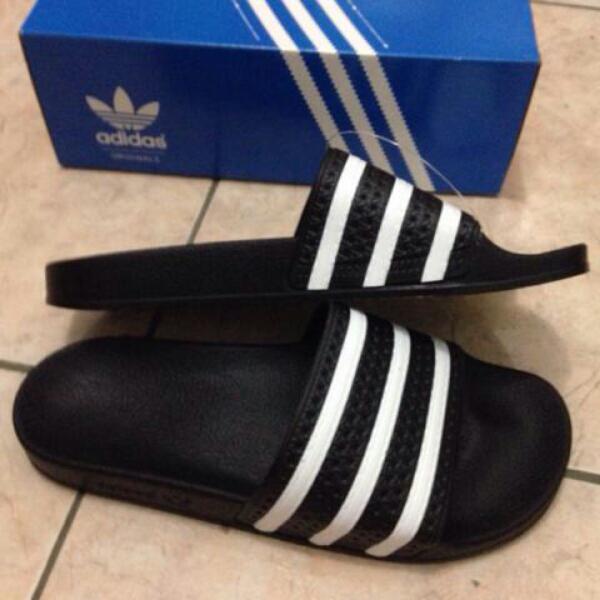 306e0056950 ... uk availability Harga Jual Harga Sandal Adidas Adilette Original - Sandal  Adidas ... d9a8f ...
