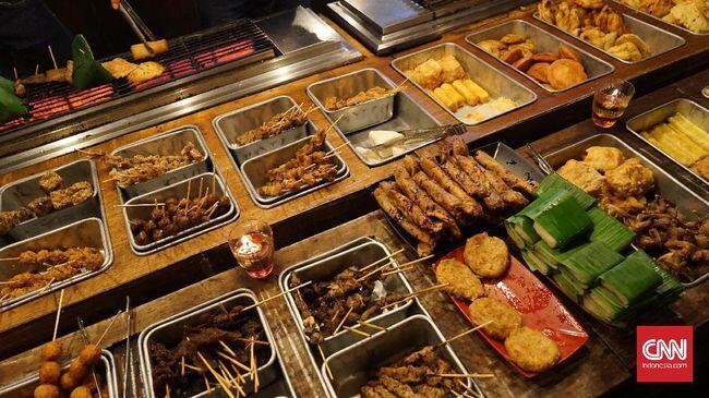 Menjajal 'Nasi Kucing' Babi di Angkringan Non-Halal Masa Kini