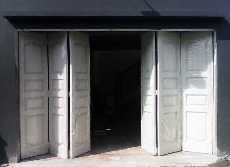 Lebih Murah Gunakan Pintu Garasi Besi Dibandingi Dengan Pintu Kayu