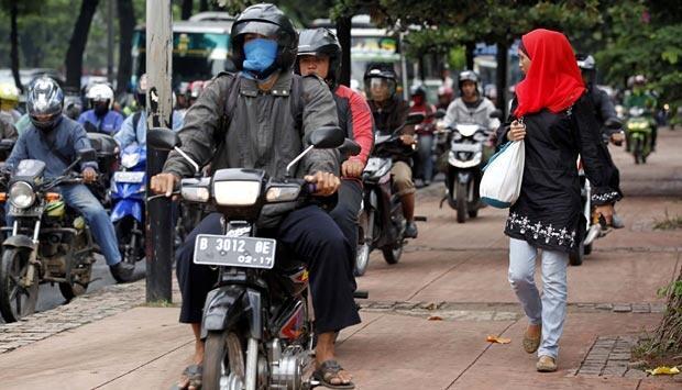 Grab Indonesia Berhentikan Pengemudi Ojek Online yang Pukul Pejalan Kaki