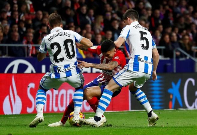 Hasil La Liga: Atletico Menang Berkat gol Godin dan Filipe Luis