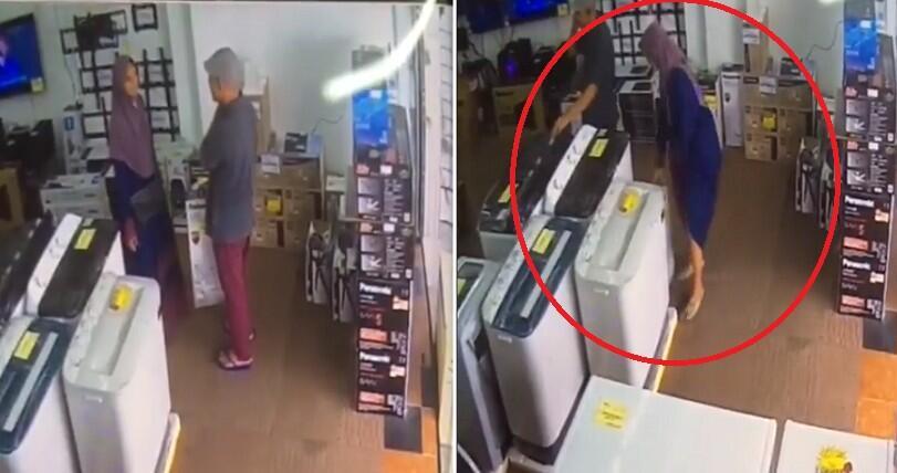 Wanita Mencuri Peralatan Elektrik Dengan Meletakkannya Di Bawah Baju Kurung