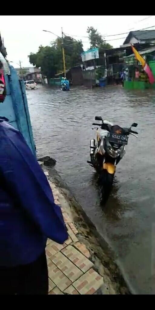 Hujan di Tangerang mengakibatkan Buruh Libur kerja