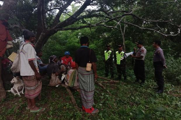 Aparat di Perbatasan Indonesia - Timor Leste Ingatkan Warga Bahaya Corona