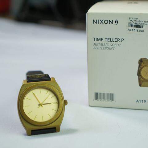 Nixon time teller gold