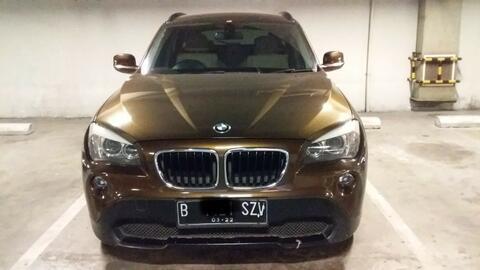 Mobil BMW X1 sDrive18ixLine 2012 Coklat
