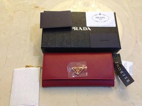 Terjual Dompet Prada Saffiano Triangle wallet ORIGINAL for women ... 4548de4a81