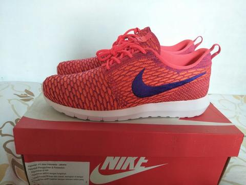 low priced dc80d 85e05 ... NIke Roshe Run Flyknit Bright Crimson . ...