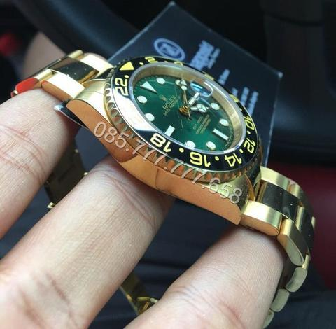 Rolex GMT master II gold on green dial