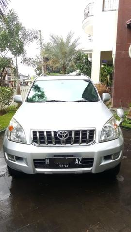 TOYOTA PRADO TX SILVER ON GREY 2004