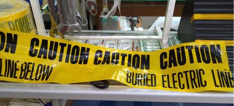 tape under ground warning caution buried electric below yellow